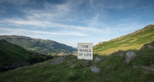 A sign on a fellside reading: The whole of life.