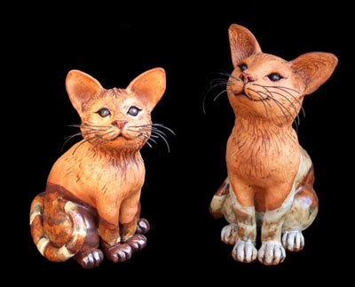 """Sitting Cats with black clay eyes small: approx. 9.5""""H x 6""""W x 9""""D medium: approx. 12""""H x 6""""W x 9""""D large: approx. 12""""H x 8""""W x 11""""D"""
