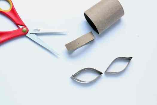 Cutting eye shapes from cardboard tube