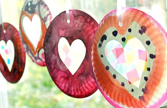Easy Valentine Crafts - Valentine's Day Suncatchers hanging in a sunny window