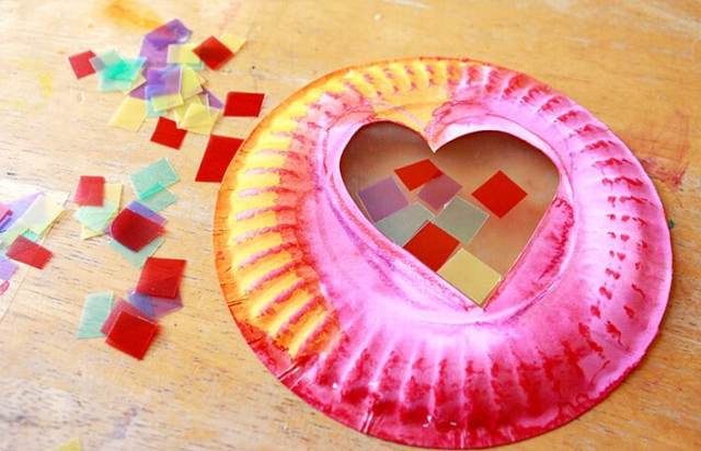 Easy Valentine Crafts - assembling the Valentine's Day Suncatchers
