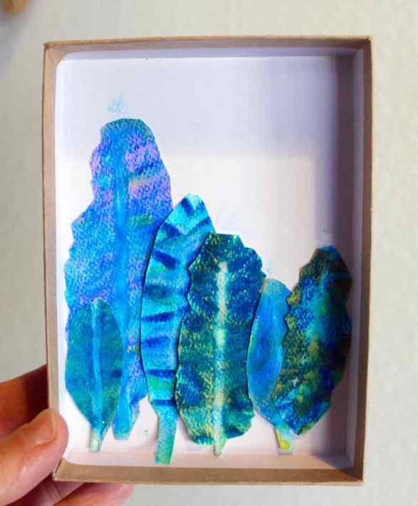 Box with drawn and painted feathers in it – an easy nature drawing and painting project for kids