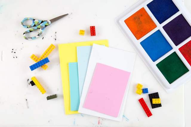 Stamp pads, LEGOs & paper for creating LEGO prints