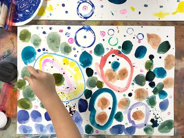Child painting Yayoi Kusama Inspired Dot Paintings for Kids