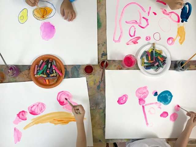 Children painting and drawing colorful dots for Yayoi Kusama inspired dot paintings