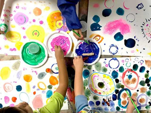 Children painting colorful circles and dots for Yayoi Kusama Inspired Dot Paintings for Kids
