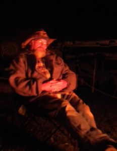 Rick Hunt by the sacred fire at night.