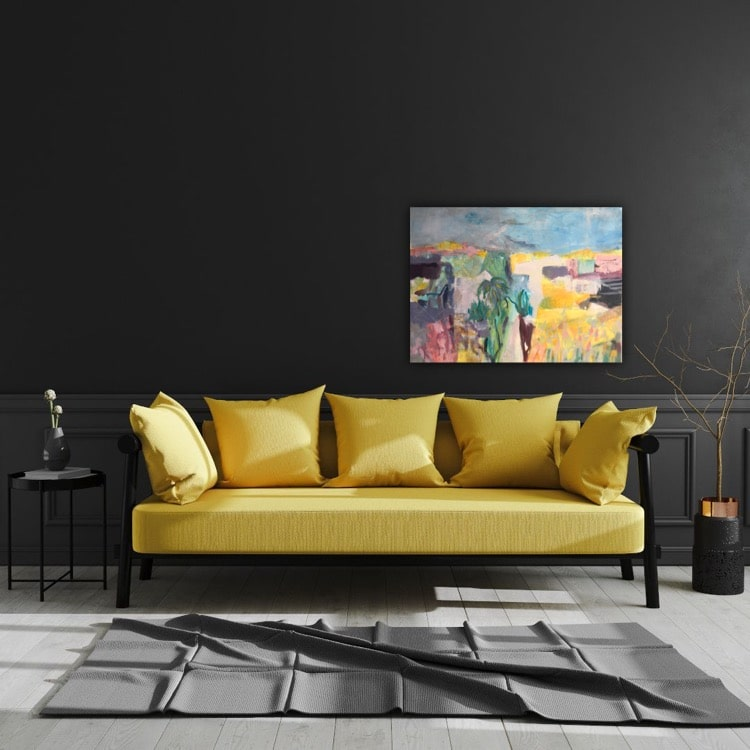 The yellow landscape painting contributes beautifully to the set up of the room with a yellow sofa.