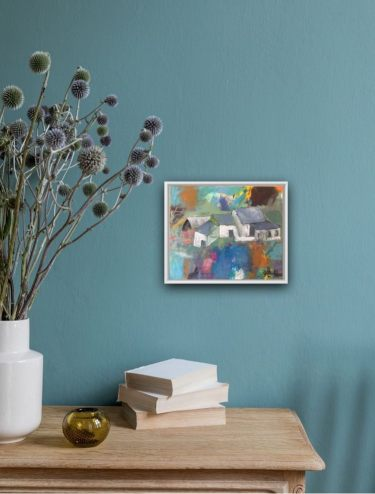 Small paintings can highlight a little corner and convert it into an eye catcher.