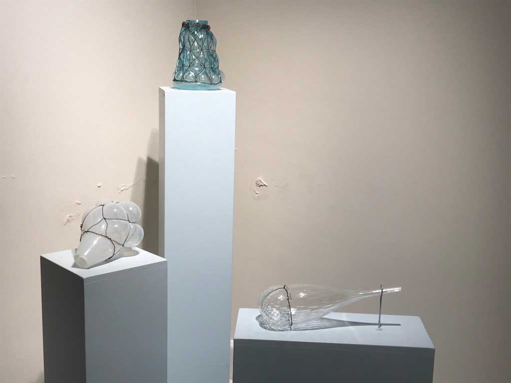 """3 Glas Objekts blown into Metal Cages"""" from Gala Fernández"""