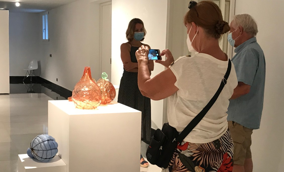 Fascinating glass objects in Marbella being photographed by visitors