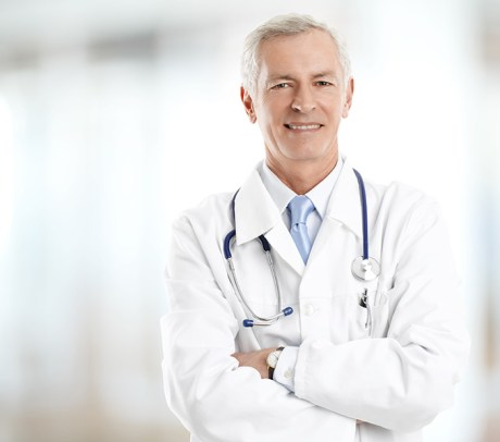 Portrait of male doctor standing at hospital.