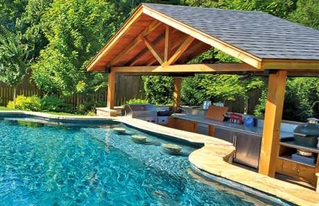 What is a Swim-Up Pool Bar?—and How to Add One to Your ... on Backyard Pool Bar Designs id=90766