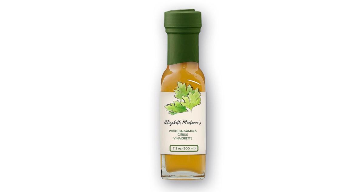 Elizabeth Monterro personal chef bottle of vinaigrette with label. Artigiana Communication Design