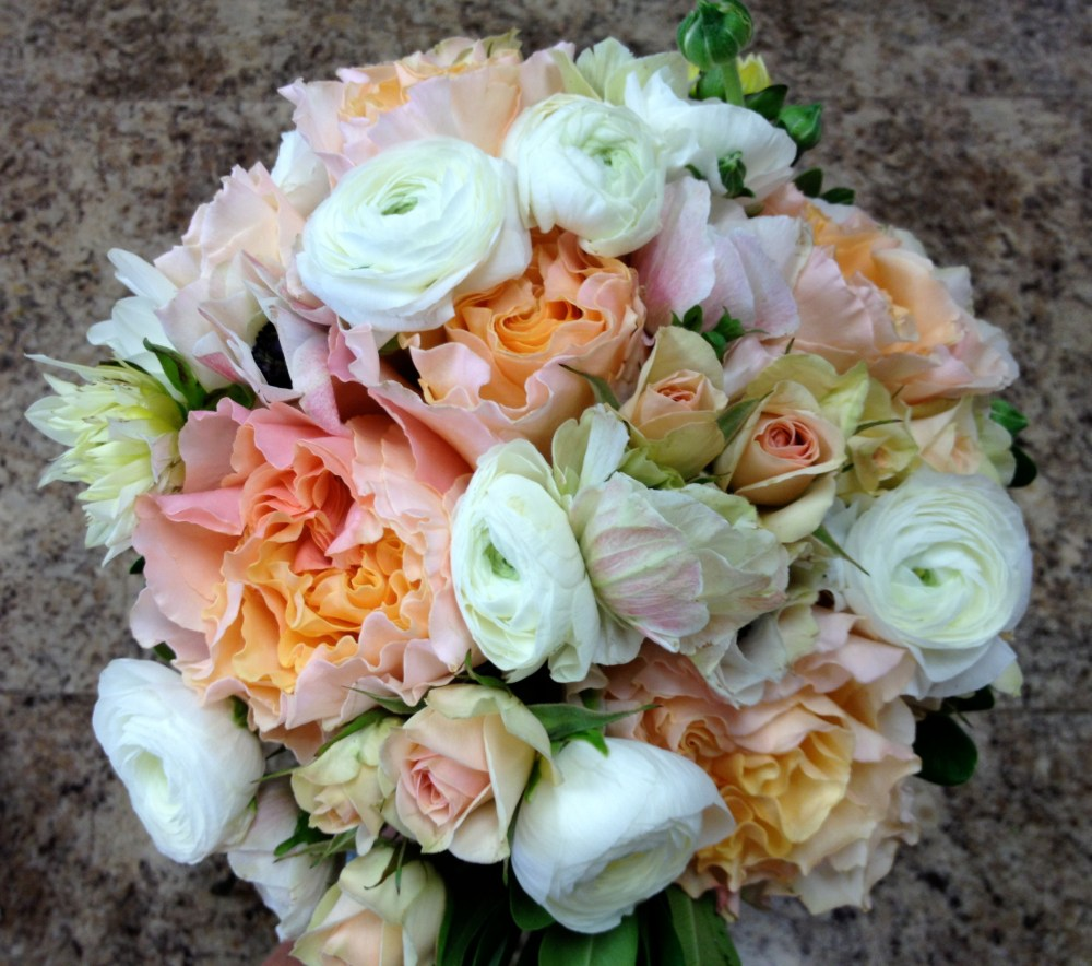 Alayna's bouquet of peach garden roses, ranunculus, anemone and spray roses.