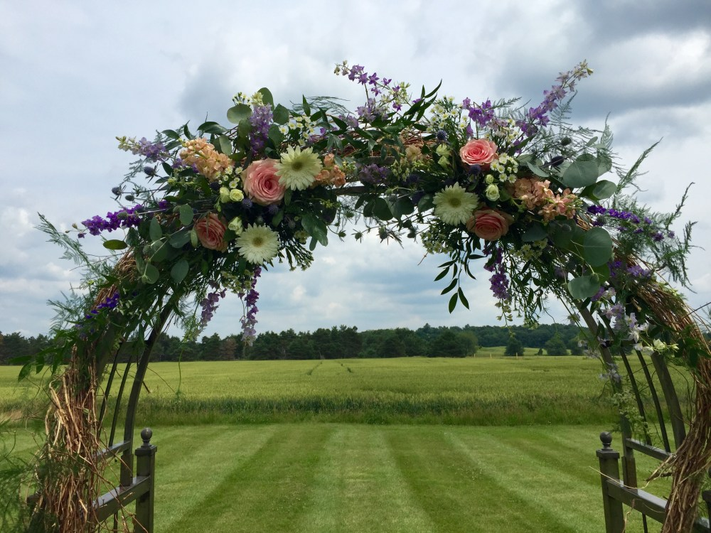 Gorgeous view through the arch at Sarah and Patrick's ceremony site- Lazy J Ranch in Milford.