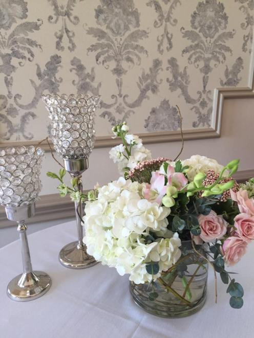 Low centerpiece- hydrangeas, roses and orchids