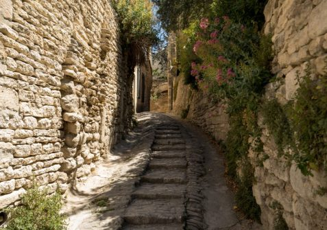 Steep alley with medieval houses in Gordes. Provence, France