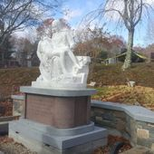 Pieta with dimensional granite pedestal assembly and installation