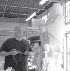 Owner, Jim Bria with unfinished sculpture the Assumption