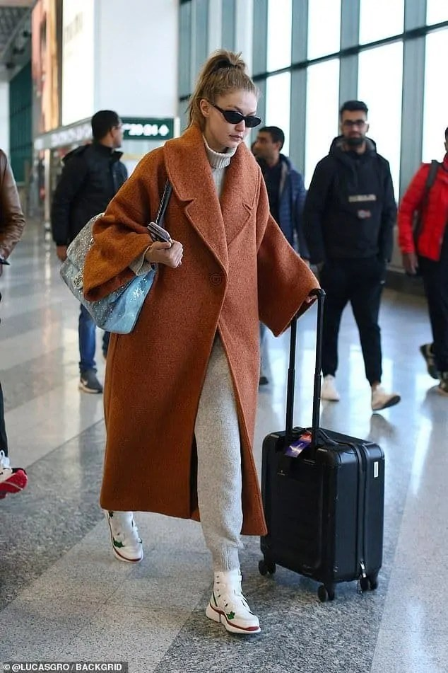 Gigi-Hadid-opts-for-comfort-in-orange-coat-as-she-jets-out-of-Milan 5