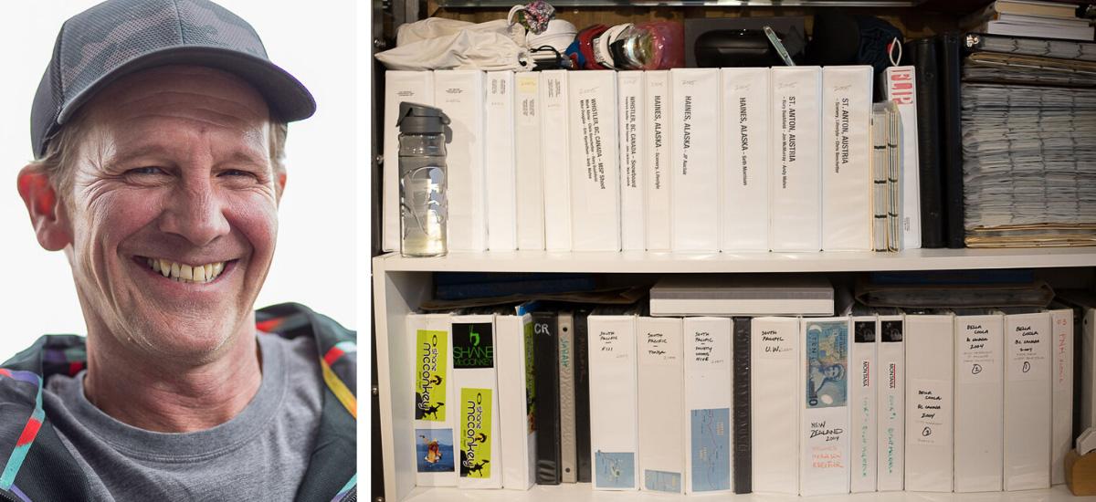 Photographer Flip McCririck + his binders of photos in his office in Colorado