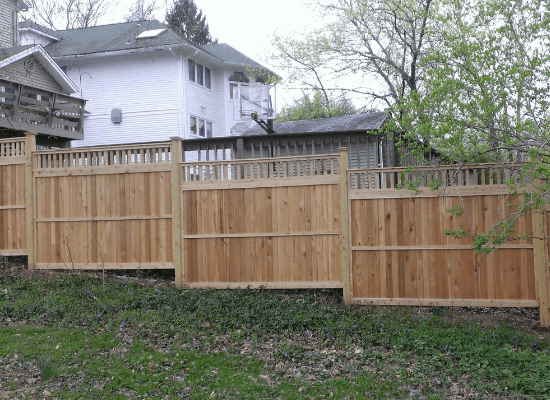 Stepped wood fence with open topper