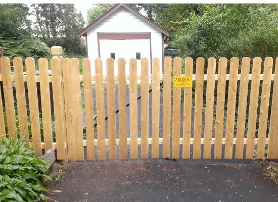 Wood picket fence with a gate