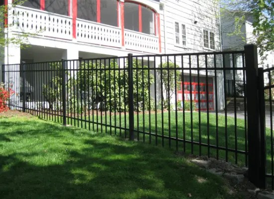 Contemporary black aluminum fence in a residential yard
