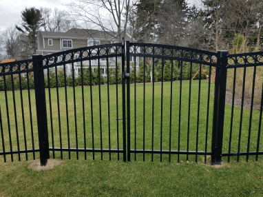 Black aluminum gate with circle embellishments