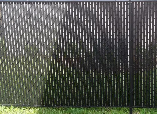 Black chain link fence with black vinyl privacy slats