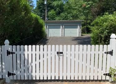 White driveway fence gate