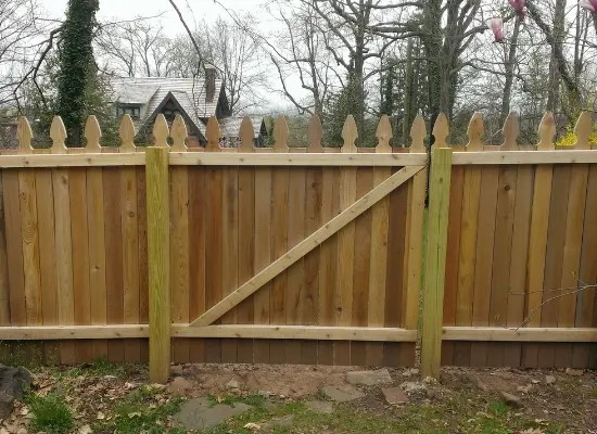 Wood picket fence and gate with dogear tops and no spacing