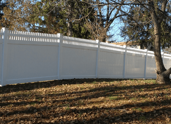 Tall white open topped PVC privacy fence installed by Artistic Fence Company