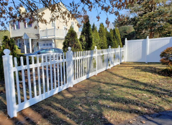White vinyl / PVC picket fence with circular caps