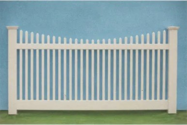 Nantucket style vinyl picket fence with scalloped top