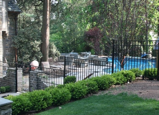 Aluminum pool fence, stepped, with residential swimming pool in the background