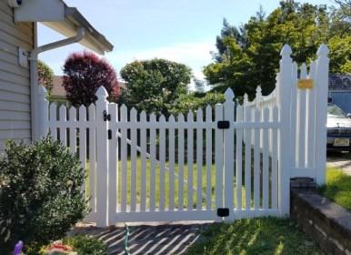 White vinyl scalloped picket fence gate door