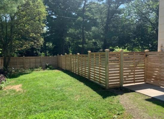 Backyard horizontal wood fence with gate