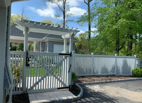 White PVC picket fence, gate, and flat top arbor - backyard garden fencing