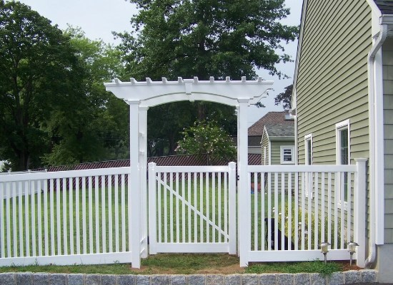 White PVC picket fence with flat top arbor and vinyl picket fence gate