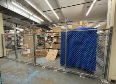 Silver indoor chain link metal fence with sliding gate