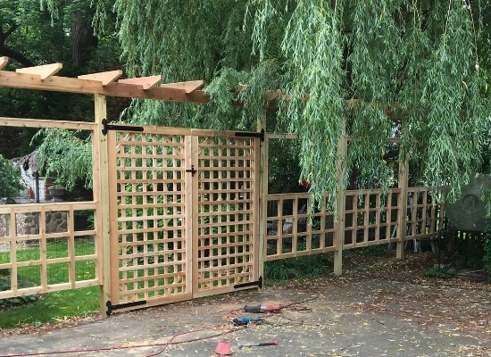 Wood lattice fence, gate, trellis, and arbor installed by Artistic Fence of northern New Jersey