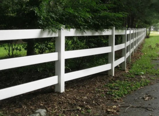 white pvc / vinyl post and rail fence with three rails