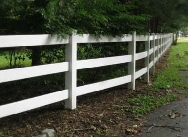 white pvc / vinyl post and rail fence with three rails