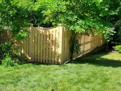 #106 wood picket fence installed by Artistic Fence company with scalloped top