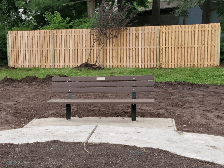 #120 Board on Board wood shadowbox fence installed at a Nutley, New Jersey park by Artistic Fence Company with a memorial bench in front