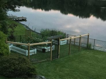 Garden fencing next to a lake