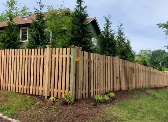 Style #104 wooden picket fence installed by Artistic Fence Company in Montclair, New Jersey