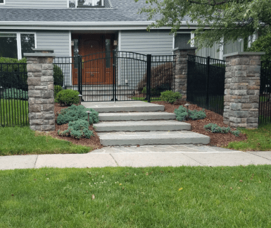 Black Vanguard aluminum fence and double gate in MOntclair, New Jersey installed by Artistic Fence and Bloomigndale Blockworks